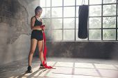 Boxing Woman Prepare To Trianing Session And Kickboxing,workout At Thai Boxing Gym.fit Female Exerci poster