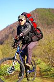 image of sakhalin  - Man-bicyclist on to road he travels on island Sakhalin. ** Note: Slight blurriness, best at smaller sizes - JPG