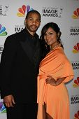 LOS ANGELES - FEB 17:  Aaron D Spears, wife arrives at the 43rd NAACP Image Awards at the Shrine Aud