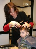 stock photo of hair cutting  - Small boy getting his hair cut - JPG