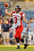 GRAZ, AUSTRIA - JULY 9: QB Michael Faulds (#3 Canada) passes the ball at the Football World Champion