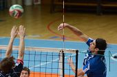 KAPOSVAR, HUNGARY - FEBRUARY 23: Andras Geiger (L) in action at a Hungarian volleyball National Championship game Kaposvar (blue) vs. Csepel (deep blue), on February 23, 2012 in Kaposvar, Hungary.