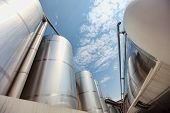 stock photo of silos  - Silver silos and tank  - JPG