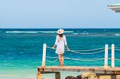 Beautiful Woman On Docks Looking To Ocean. Vacations Lifestyle. Woman Relaxing On The Beach. Vacatio poster