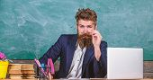 Teacher Formal Wear Sit Table Classroom Chalkboard Background. Teacher Concentrated Bearded Mature S poster