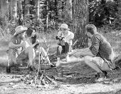 Tourists Hikers Sit On Log Relaxing Waiting Picnic Snack. Company Having Hike Picnic Nature Backgrou poster