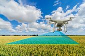 UAV drone multicopter flying with high resolution digital camera over a crops field scanning for pro poster