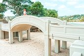 Woman Standing And Gazing Out At The Veiws From  The Arched Bridge Balmoral Beach poster
