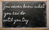 Expression -  You Never Know What You Can Do Until You Try - Written On A School Blackboard With Cha