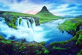Unique landscape with Kirkjufellsfoss waterfall and Kirkjufell mountain, Iceland, Europe. poster