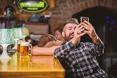 Man In Bar Drinking Beer. Take Selfie Photo To Remember Great Evening In Pub. Man Bearded Hipster Ho poster