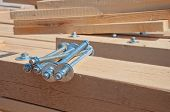 Wooden Beams For Steel Structure For Further Construction. Fastening Elements Of Wooden Beams Among  poster