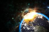 Space scene of asteroid impact on earth