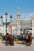 Carriages With Cabbies In Bruges