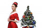 cheerful retro girl standing near christmas tree