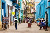 HAVANA-DECEMBER 14:Street scene with cuban people and colorful old buildings December 14,2012 in Hav