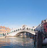 Rialto Bridge (ponte Di Rialto) In Venice, Italy On A Sunny Day