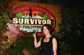 LOS ANGELES - DEC 16:  Denise Stapley posing for photos on the press line after winning  'Survivor: