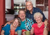 Laughing Seniors In Cafe