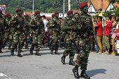 KUALA LUMPUR - AUGUST 31: Paratroopers from the 10th Airborne Brigade march on the city streets as c