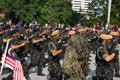KUALA LUMPUR - AUGUST 31: VAT 69 commandoes from Police force march on the city streets celebrating