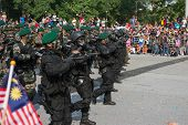 KUALA LUMPUR - AUGUST 31: Malaysian commandoes in green beret from RGK special forces march on the c