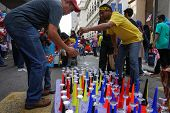 KUALA LUMPUR - AUGUST 31: A street vendor sells air horns to revelers on the city streets as they ce