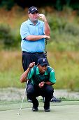 NORTON, MA-SEP 1: Tiger Woods (bottom) reads the green as Kevin Stadler stands during the third roun