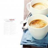 two cups of coffee with blue napkin (with sample text)