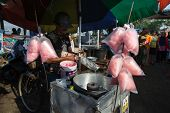 PADANG - AUGUST 25: A vendor prepares sweet candy floss for sale at a village market in Padang, West Sumatera, Indonesia on August 25, 2013. This market attract local villagers at this seaside town.
