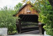 stock photo of covered bridge  - This is one of the many covered bridges that can be seen in Vermont - JPG