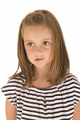 Young Girl With Big Eyes In Black And White Striped Shirt With Somber Expression Biting Lip