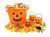 stock photo of jack o lanterns  - Halloween Jack o Lantern pails with pile of candy over white - JPG