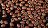 Background Texture Of Roasted Coffee Beans On Black Background