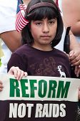 Girl With Flag And Sign: Reform, Not Raids