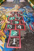 stock photo of hopscotch  - schoolyard Hopscotch court drawn by chalk on pavement - JPG