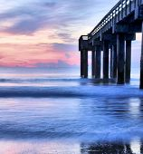 image of florida-orange  - The St Augustine Beach Pier at sunrise - JPG