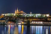 foto of stone sculpture  - night view of Prague Castle - JPG