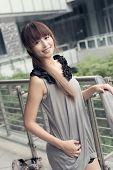 Attractive Asian woman in modern city, Taipei, Taiwan, Asia.