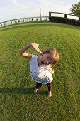 little girl being goofy in park
