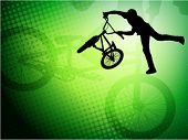 bmx stunt cyclist on the abstract background
