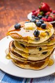 picture of ooze  - Big Pile of American Blueberry Pancakes with Berries and Maple Syrup - JPG