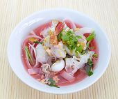 stock photo of wanton  - rice noodles in pink soup - JPG
