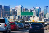 image of traffic signal  - San Francisco city traffic in rush hour with downtown skyline California USA - JPG