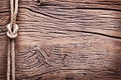Sailor's knot over old wooden background.