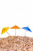 Cocktail Umbrella in Sand Mound with Shells