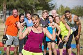 Enthusiastic Fitness Instructor With Group