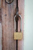 Old Master Key On Wood Door