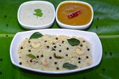 stock photo of pongal  - Ven Pongal is a south indian breakfast made with rice and lintel - JPG