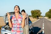 stock photo of nervous breakdown  - Desperate woman praying desperately because of car problems - JPG